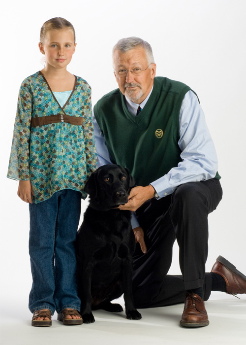 Dr. Steve Withrow with dog and girl